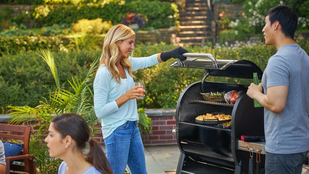woman grilling dining al fresco grilled dinner