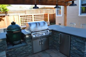 custom kitchen with grill and big green egg