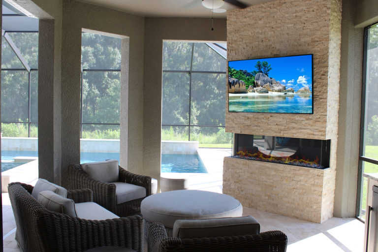 Synergy tampa outdoor kitchen rock wall and electric fireplace