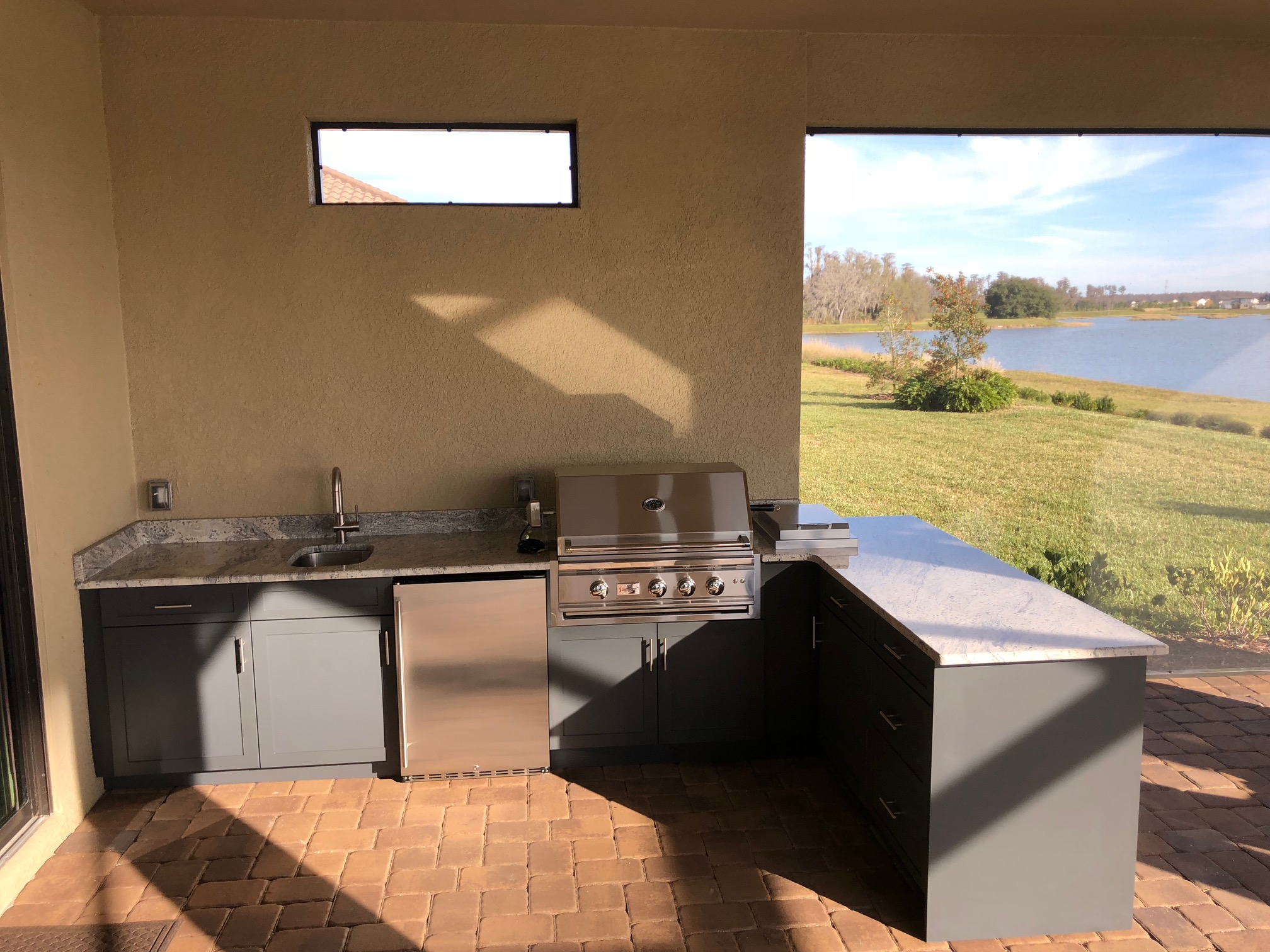 Gray L-Shaped Outdoor Kitchen