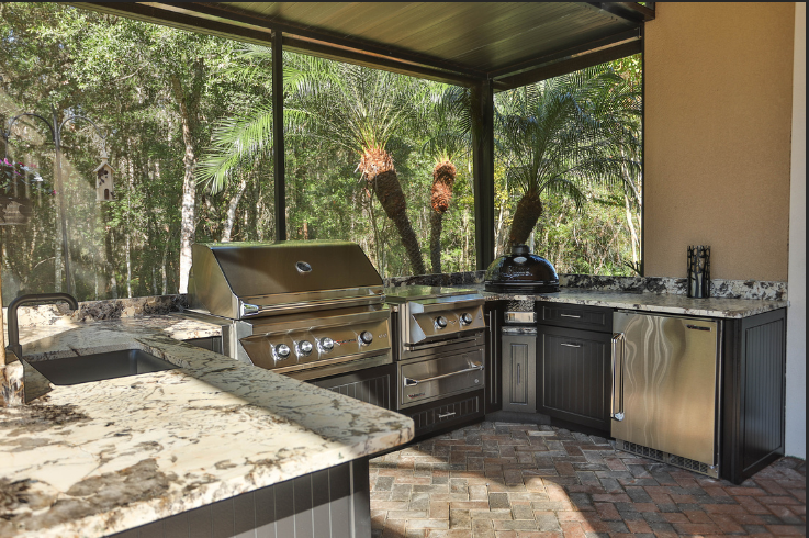 Custom outdoor kitchen area with Primo Grill